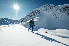 Man Ski Touring On Snowcapped Steinkarspitze, Lechtal Alps, Tyrol, Austria