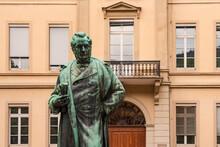 Psychology Institute In Heidelberg University With Robert William Statue In Anatomiegarten At The Old City, Heidelberg, Germany