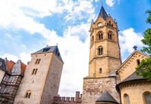 Clock Tower Of St Nicholas Church Against Cloudy Sky At Eisenach, Germany