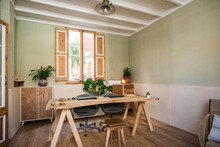 Empty Office With Chairs And Wooden Table At Workshop