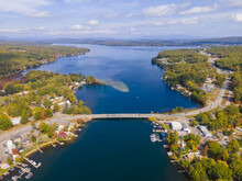 Aerial View Of Lake Winnisquam And Winnisquam Sand Bar With US Route 3 Bridge Between Town Of Belmont And Sanbornton In New Hampshire NH, USA.