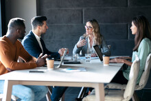 Business People Having Discussion In Meeting While Sitting At Office