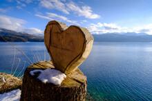 Germany, Bavaria, Wooden Heart On Stump At Walchensee Lake