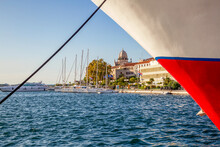 Croatia, Sibenik-Knin County, Sibenik, Bow Of Moored Ship With Marina And Cathedral Of Saint James In Background