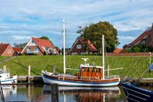 Germany, Lower Saxony, Greetsiel, Fishing Boat Moored Along Town Harbor