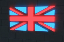 Illuminated British Flag On Black Brick Wall