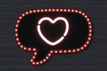 Illuminated Speech Bubble With Heart Shape On Black Brick Wall