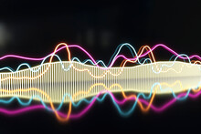 Illuminated Colorful Frequency Pattern Against Black Background