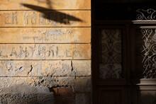 Shadow Of Street Light On Broken Wall