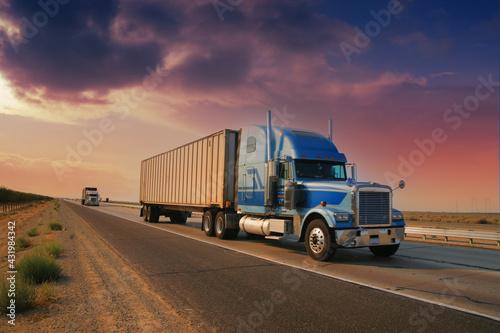Freight truck driving on highway desert road at sunset. California, USA - fototapety na wymiar