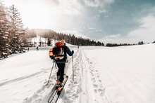 Active Senior Man Skiing On Snow Covered Land During Vacation