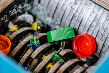 Plastic Bottle Caps Being Recycled In Machinery