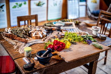 Variety Of Herbs With Flowers On Table