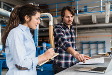 Male Expertise Pointing At Laptop While Working With Colleague In Industry