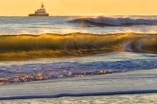 Fishing Boat At Sunrise On The Atlantic Ocean;  Near Virginia Beach, Virginia