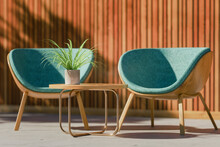 Three Dimensional Render Of Two Retro Styled Chairs, Coffee Table And Potted Plant Standing On Balcony