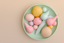 Three Dimensional Render Of Plate With Pastel Colored Fruits