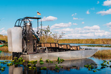 Airboat In Lake At Everglades National Park Against Blue Sky