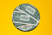 Studio Shot Of Bunch Of One Dollar Bills Inside Circular Hole