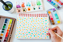 Painting Pastel Colors Terrazzo Pattern With Watercolors On Spiral Notebook