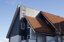 Modern Roof House Design With Red Tiles Against Clear Blue Sky