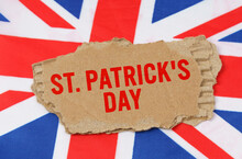 Against The Background Of The Flag Of Great Britain Lies Cardboard With The Inscription - St. Patricks Day
