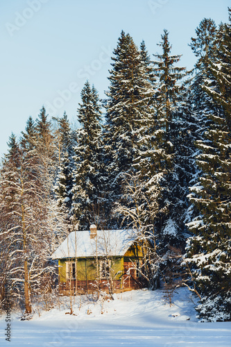 old house in the winter forest