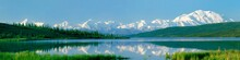 The Rugged Snow-capped Alaska Range And Massive Mount McKinley Reflect In Wonder Lake On A Rare Clear And Calm Morning In Denali National Park, Alaska