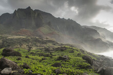 Rugged Mountains Rise Steeply Out Of The Ocean On Kauai's Napali Coast.