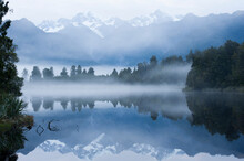 Sunrise At Lake Matheson On The West Of New Zealand's South Island