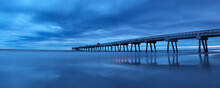Jacksonville, Fl: Reflections Of The Pier Bounce Off The Incoming Tide
