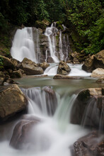 A Tropical Waterfall Surrounded By Lush Green Jungle Hidden In Southern Costa Rica.