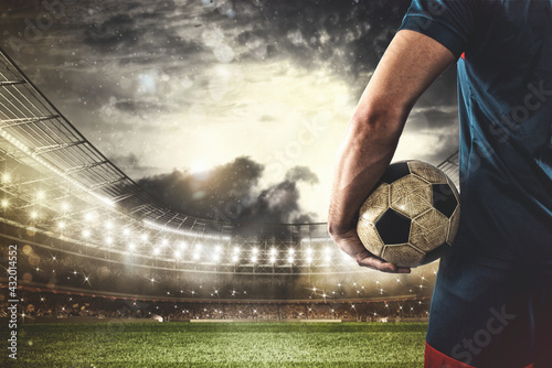Murais de parede Soccer player ready to play or kick the ball in his hands at the stadium
