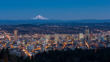 Portland's City Lights And A Snow-capped Mt Hood In A Clear Winter Dusk