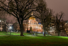 The Massachusetts State House As Viewed At Night From The Boston Commons In Boston, MA.