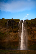 Seljalandsfoss, A Waterfall Fed By Ice Melt From The Eyjafjallajokull Glacier, In Southern Iceland.