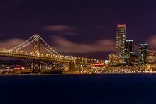 Night Shot Of The Downtown San Francisco Skyline And The End Of The Bay Bridge.