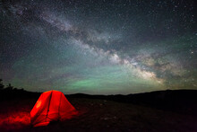 Milky Way Arching Across The Night Sky With Airglow Above A Tent, Bridger-Teton National Forest, Wyoming