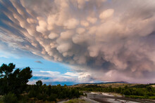 Lightning Strikes From Mammatus Clouds Above The Sleeping Indian In Grand Teton National Park, Wyoming.