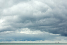 A Shipping Vessel Cruises Through Block Island Sound Off The Coast Of Rhode Island Beneath Passing Storm Clouds.