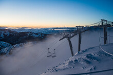 Ski Lift At Sunrise With Fog