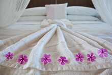 Flower Details On White Towels At Hotel Los Flamingos, Holbox Island, Mexico.