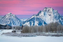 A Frozen Oxbow Bend Lies Below Mount Moran And The Teton Mountains On A Cold January Morning In Grand Teton National Park, Wyoming.