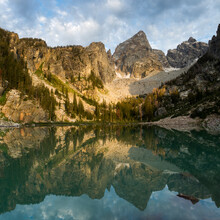 The Grand Teton Towers Above Nearby Peaks And The Turquoise Waters Of Delta Lake In Grand Teton National Park, Wyoming.