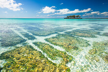 Calm Waters Of The Caribbean With A Small Island In The Bahamas.