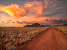 Dirt Road In The Desert At Sunset With A Colorful Sky, Tiras Mountains, Namibia