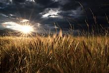 Sun Bursts Through The Clouds As It Sets Over The Sangre De Cristo Mountains Near Westcliffe, Colorado