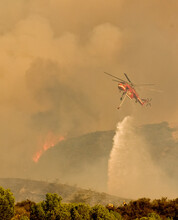 Helicopter Dropping Water On Fire