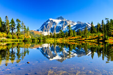 North Cascades National Park, Washington: Mount Shuksan's Reflection On Picture Lake In The Fall.