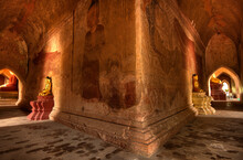 Statues And Paintings Of Buddha Decorate This Hallway Inside One Of The 2000  Temples At Bagan Located In The Country Of Burma (Myanmar)